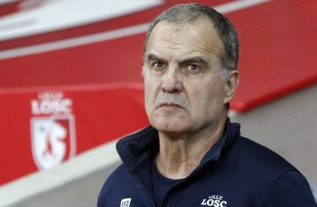 Lille coach Marcelo Bielsa looks on before their French League one soccer match against Marseille at the Lille Metropole stadium, in Villeneuve d'Ascq, northern France, Sunday, Oct. 29, 2017. (AP Photo/Michel Spingler)