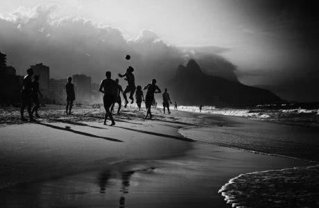 RIO DE JANEIRO, BRAZIL - JUNE 09: (EDITOR'S NOTE: Image was processed using digital filters.)  Locals play Football on Ipanema Beach on June 9, 2014 in Rio de Janeiro, Brazil. Photo by Ryan Pierse - FIFA/FIFA via Getty Images)