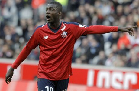 Lille's Nicolas Pepe gestures during his League One soccer match match Lille and Montpellier at the Lille Metropole stadium, in Villeneuve d'Ascq, northern France, Saturday, Feb. 17, 2019. (AP Photo/Michel Spingler)