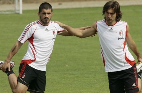 AC Milan midfielders Gennaro Gattuso, left, and Andrea Pirlo during a training session at the Milanello sports center in Carnago, northern Italy, Wednesday, May 16, 2007. AC Milan will play Liverpool in the final soccer match of the Champions League, in Athens next May 23. (AP Photo/Luca Bruno)