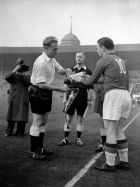 Billy Wright (left), England's captain and Ferenc Puskas, Hungarian captain exchange pennants on the field before the start of the England vs Hungary football match at the Empire Stadium in Wembley. Hungary won the match 6-3 marking England's first ever home defeat.