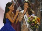 Miss Universe 2015 Pia Wurtzbach, left, prepares to crown Iris Mittenaere of France shortly after being proclaimed the Miss Universe 2016 in coronation Monday, Jan. 30, 2017, at the Mall of Asia in suburban Pasay city, south of Manila, Philippines. (AP Photo/Bullit Marquez)