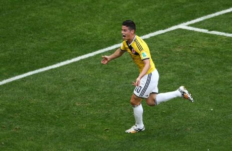 BRASILIA, BRAZIL - JUNE 19: James Rodriguez of Colombia celebrates after scoring his team's first goal during the 2014 FIFA World Cup Brazil Group C match between Colombia and Cote D'Ivoire at Estadio Nacional on June 19, 2014 in Brasilia, Brazil.  (Photo by Adam Pretty/Getty Images)