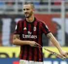 AC Milan's Leonardo Bonucci removes the captain's armband after receiving a red card from the referee during a Serie A soccer match between AC Milan and Genoa, at the San Siro stadium in Milan, Italy, Sunday, Oct. 22, 2017. (AP Photo/Luca Bruno)