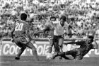 Englands Gary Lineker, in white shirt, is brought down during the Football World Cup Group F match between England and Portugal, in Monterrey, Mexico, on June 3, 1986. Portugal defeated England 1-0. (AP Photo)