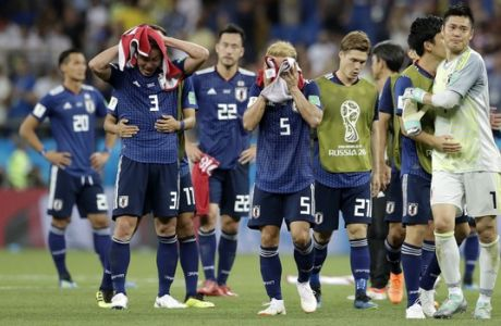 Japan's players react as they walk on the pitch after losing the round of 16 match between Belgium and Japan at the 2018 soccer World Cup in the Rostov Arena, in Rostov-on-Don, Russia, Monday, July 2, 2018. (AP Photo/Petr David Josek)
