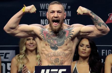 FILE - In this Friday, Nov. 11, 2016, file photo, Conor McGregor stands on a scale during the weigh-in event for his fight against Eddie Alvarez in UFC 205 mixed martial arts at Madison Square Garden in New York. (AP Photo/Julio Cortez, File)