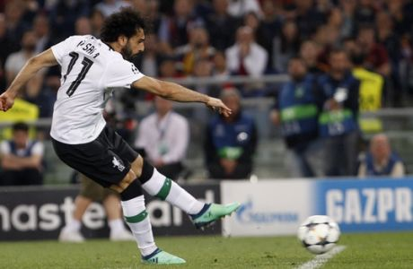 Liverpool's Mohamed Salah fires a shot during the Champions League semifinal second leg soccer match between Roma and Liverpool at the Olympic Stadium in Rome, Wednesday, May 2, 2018. (AP Photo/Riccardo De Luca)