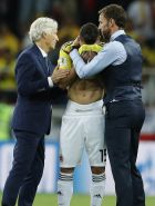 Colombia head coach Jose Pekerman, left, and England head coach Gareth Southgate, right, comfort Colombia's Mateus Uribe after the round of 16 match between Colombia and England at the 2018 soccer World Cup in the Spartak Stadium, in Moscow, Russia, Tuesday, July 3, 2018. (AP Photo/Alastair Grant)