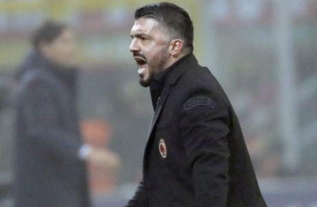 AC Milan coach Gennaro Gattuso celebrates a 2-1 win at the end of a Serie A soccer match between AC Milan and Lazio, at the San Siro stadium in Milan, Italy, Sunday, Jan. 28, 2018. (AP Photo/Luca Bruno)