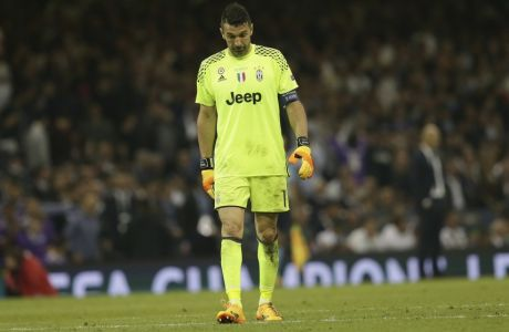 Juventus goalkeeper Gianluigi Buffon grimaces during the Champions League final soccer match between Juventus and Real Madrid at the Millennium Stadium in Cardiff, Wales, Saturday June 3, 2017. (AP Photo/Tim Ireland)
