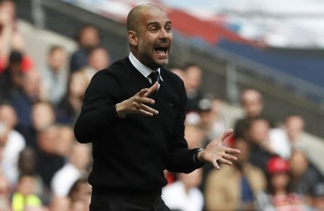 Manchester City manager Pep Guardiola reacts during the English FA Cup semifinal soccer match between Arsenal and Manchester City at Wembley stadium in London, Sunday, April 23, 2017. (AP Photo/Kirsty Wigglesworth)