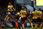 West Ham United's Andy Carroll heads the ball towards goal in a crowded penalty area