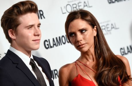 """Glamour's """"The Fashion Force"""" honoree, Victoria Beckham and her son Brooklyn Beckham, attend the 25th Annual Glamour Women of the Year Awards at Carnegie Hall on Monday, Nov. 9, 2015, in New York. (Photo by Evan Agostini/Invision/AP)"""