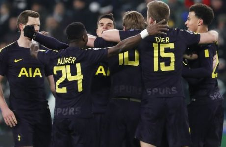 Tottenham players celebrate after Christian Eriksen scored during the Champions League, round of 16, first-leg soccer match between Juventus and Tottenham Hotspurs, at the Allianz Stadium in Turin, Italy, Tuesday, Feb. 13, 2018. (AP Photo/Antonio Calanni)