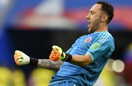 Colombia goalkeeper David Ospina celebrates after teammate Yerry Mina scored the opening goal during the group H match between Senegal and Colombia, at the 2018 soccer World Cup in the Samara Arena in Samara, Russia, Thursday, June 28, 2018. (AP Photo/Martin Meissner)