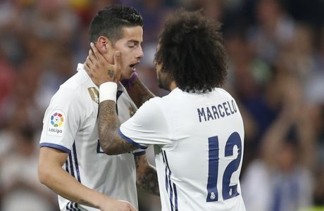 Real Madrid's James Rodriguez, left, celebrates with his teammate Real Madrid's Marcelo after scoring during a Spanish La Liga soccer match between Real Madrid and Barcelona, dubbed 'el clasico', at the Santiago Bernabeu stadium in Madrid, Spain, Sunday, April 23, 2017. (AP Photo/Francisco Seco)