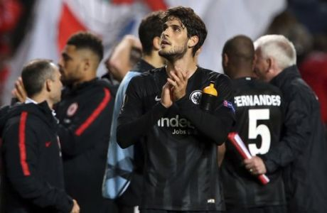 Frankfurt's Goncalo Paciencia, center, applauds to supporters at the end of the Europa League quarterfinals, first leg, soccer match between Benfica and Eintracht Frankfurt at the Luz stadium in Lisbon, Thursday, April 11, 2019. (AP Photo/Armando Franca)