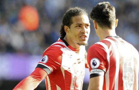 "FILE- In this Sunday, Oct. 23, 2016 file photo, Southampton's Virgil van Dijk, left, with a team mate during the English Premier League soccer match between Manchester City and Southampton at the Etihad Stadium in Manchester, England. Southampton defender says he has handed in a transfer request to leave the English Premier League club, expressing frustration that interest from ""multiple top clubs have been consistently rebuffed."" (AP Photo/Rui Vieira, File)"