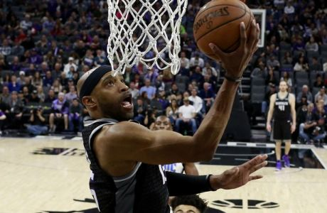 Sacramento Kings guard Vince Carter goes to the basket against the Orlando Magic during the second half of an NBA basketball game Friday, March 9, 2018, in Sacramento, Calif. The Kings won 94-88. (AP Photo/Rich Pedroncelli)