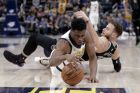 Indiana Pacers forward Thaddeus Young (21) makes a steal from Detroit Pistons forward Blake Griffin (23) during the second half of an NBA basketball game in Indianapolis, Friday, Dec. 28, 2018. The Pacers defeated the Pistons 125-88. (AP Photo/Michael Conroy)