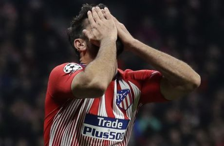 Atletico forward Diego Costa after missing to score during the Champions League round of 16 first leg soccer match between Atletico Madrid and Juventus at Wanda Metropolitano stadium in Madrid, Wednesday, Feb. 20, 2019. (AP Photo/Manu Fernandez)