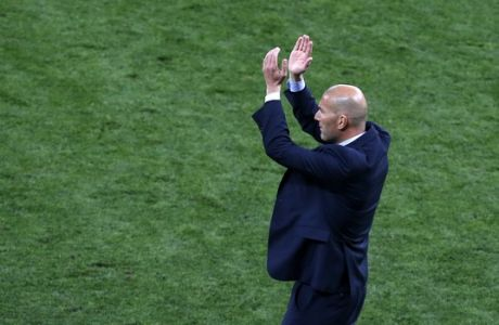 Real Madrid coach Zinedine Zidane applauds during the Champions League Final soccer match between Real Madrid and Liverpool at the Olimpiyskiy Stadium in Kiev, Ukraine, Saturday, May 26, 2018. (AP Photo/Darko Vojinovic)