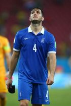 RECIFE, BRAZIL - JUNE 29:  Konstantinos Manolas of Greece looks dejected after being defeated by Costa Rica  in a penalty shootout during the 2014 FIFA World Cup Brazil Round of 16 match between Costa Rica and Greece at Arena Pernambuco on June 29, 2014 in Recife, Brazil.  (Photo by Paul Gilham/Getty Images)