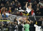 Germany's Lukas Podolski is thrown into the air after the friendly soccer match between Germany and England in Dortmund, Germany, Wednesday, March 22, 2017. Podolski retired from the national team after 130 matches and 49 scored goals. (AP Photo/Frank Augstein)