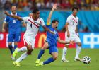 RECIFE, BRAZIL - JUNE 29: Michael Umana of Costa Rica challenges Giorgos Karagounis of Greece during the 2014 FIFA World Cup Brazil Round of 16 match between Costa Rica and Greece at Arena Pernambuco on June 29, 2014 in Recife, Brazil.  (Photo by Ian Walton/Getty Images)