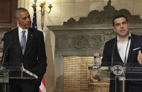U.S. President Barack Obama, right, and Greek Prime Minister Alexis Tsipras hold a news conference after their meeting at Maximos Mansion in Athens on Tuesday, Nov. 15, 2016. Obama is opening his final foreign trip as president with reassuring words about the U.S. commitment to NATO even as he prepares to hand off to a Donald Trump administration. (AP Photo/Yorgos Karahalis, Pool)