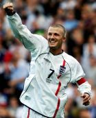 "A file picture dated 06 October 2001 of England's David Beckham celebrating after scoring an injury-time equaliser against Greece during the World Cup qualifying match at Old Trafford in Manchester. Real Madrid have reached an agreement to sign English captain David Beckham in what the club sees as the ""transfer of the century"", Madrid radio station Cadena SER said Tuesday 17 June 2003 . It said the deal was seen as more important than Real's signing, in successive summers, of Luis Figo, Zinedine Zidane and a fee of 25 million euros had been agreed with Beckham's club Manchester United. Earlier reports had said the deal was worth 22 million pounds, or around 30 million euros.  EPA P"