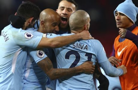 Manchester City's Nicolas Otamendi, center, celebrates with teammates at the end of the English Premier League soccer match between Manchester United and Manchester City at Old Trafford Stadium in Manchester, England, Sunday, Dec. 10, 2017. City won 2-1. (AP Photo/Dave Thompson)