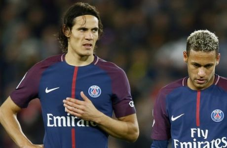 Paris Saint Germain's Edinson Cavani, left, and Neymar look on prior to shoot a free kick during their French League One soccer match between PSG and Olympique Lyon at the Parc des Princes stadium in Paris, France, Sunday, Sept. 17, 2016. (AP Photo/Francois Mori)