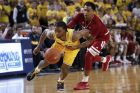 Michigan guard Zavier Simpson (3) is fouled by Indiana guard Devonte Green (11) in the second half of an NCAA college basketball game in Ann Arbor, Mich., Sunday, Jan. 6, 2019. (AP Photo/Paul Sancya)