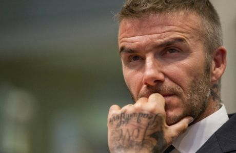FILE - In this Thursday, July 12, 2018 file photo David Beckham listens during a public hearing for his proposed Major League Soccer stadium and commercial development at City Hall in Miami. (AP Photo/Wilfredo Lee, File)