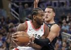 Toronto Raptors' Kawhi Leonard, left, makes a move to get around Orlando Magic's Aaron Gordon during the first half of an NBA basketball game, Tuesday, Nov. 20, 2018, in Orlando, Fla. (AP Photo/John Raoux)