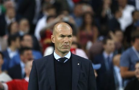 Real Madrid coach Zinedine Zidane stands on the sideline during the Champions League Final soccer match between Real Madrid and Liverpool at the Olimpiyskiy Stadium in Kiev, Ukraine, Saturday, May 26, 2018. (AP Photo/Pavel Golovkin)