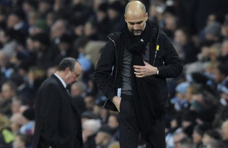 Manchester City coach Pep Guardiola and Newcastle manager Rafa Benitez, left, walk on the sidelines during the English Premier League soccer match between Manchester City and Newcastle United at the Etihad Stadium in Manchester, England, Saturday, Jan. 20, 2018. (AP Photo/Rui Vieira)