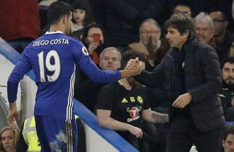 Chelsea's Diego Costa, left, shakes hands with Chelsea's team manager Antonio Conte during the English Premier League soccer match between Chelsea and Hull City at Stamford Bridge stadium in London, Sunday, Jan. 22, 2017. (AP Photo/Frank Augstein)