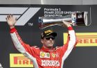 Ferrari driver Kimi Raikkonen, of Finland, celebrates after winning the Formula One U.S. Grand Prix auto race at the Circuit of the Americas, Sunday, Oct. 21, 2018, in Austin, Texas. (AP Photo/Darron Cummings)