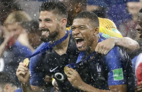 France's Kylian Mbappe, right, and teammate Olivier Giroud celebrates after the final match between France and Croatia at the 2018 soccer World Cup in the Luzhniki Stadium in Moscow, Russia, Sunday, July 15, 2018. (AP Photo/Natacha Pisarenko)