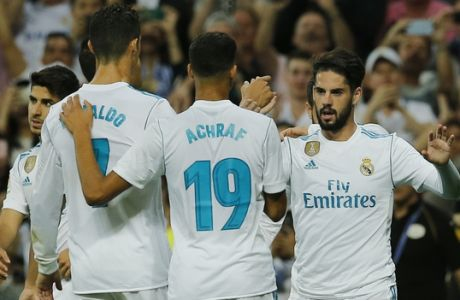 Real Madrid's Isco, right, celebrates with team mates after scoring the opening goal during a Spanish La Liga soccer match between Real Madrid and Espanyol at the Santiago Bernabeu stadium in Madrid, Spain, Sunday, Oct. 1, 2017. (AP Photo/Paul White)