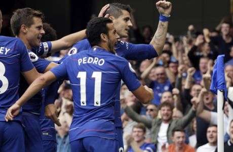 Chelsea's Alvaro Morata, right, celebrates after scoring his side's second goal during the English Premier League soccer match between Chelsea and Arsenal at Stamford bridge stadium in London, Saturday, Aug. 18, 2018. (AP Photo/Tim Ireland)