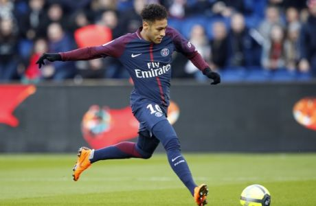 PSG's Neymar runs with the ball during the French League One soccer match between Paris Saint Germain and Strasbourg, at the Parc des Princes stadium in Paris, France, Saturday, Feb. 17, 2018. (AP Photo/Francois Mori)