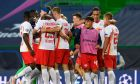 RB Leipzig players celebrate after winning their Champions League quarterfinal match against Atletico Madrid at the Jose Alvalade stadium in Lisbon, Portugal, Thursday, Aug. 13, 2020. (Lluis Gene/Pool Photo via AP)