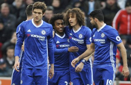 Chelsea's Willian, centre left, celebrates after scoring with Chelsea's David Luiz, centre right, during the English Premier League soccer match between Stoke City and Chelsea at the Britannia Stadium, Stoke on Trent, England, Saturday, March 18, 2017. (AP Photo/Rui Vieira)