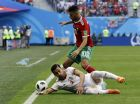 Iran's Ehsan Haji Safi, bottom, and Morocco's Younes Belhanda, top, fight for the ball during the group B match between Morocco and Iran at the 2018 soccer World Cup in the St. Petersburg Stadium in St. Petersburg, Russia, Friday, June 15, 2018. (AP Photo/Themba Hadebe)