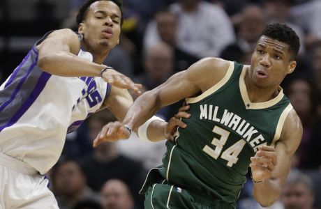 Sacramento Kings forward Skal Labissiere, left and Milwaukee Bucks forward Giannis Antetokounmpo go for the ball during the first half of an NBA basketball game, Wednesday, March 22, 2017, in Sacramento, Calif. (AP Photo/Rich Pedroncelli)