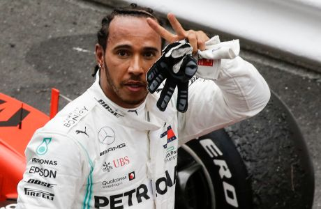 Mercedes driver Lewis Hamilton of Britain celebrates after he wins the Monaco Formula One Grand Prix race, at the Monaco racetrack, in Monaco, Sunday, May 26, 2019. (AP Photo/Luca Bruno)
